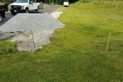 French drain installed to prevent water damage to the driveway