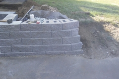 Wood retaining wall repacement